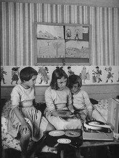Little girls reading and listening to fairytale records.