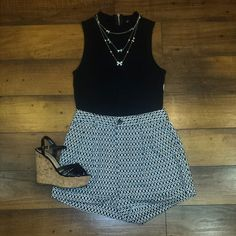 These black and white printed shorts are so fun! We love them paired with a crop top, wedges and statement jewelry! So cute!