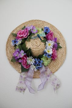 Straw hat, floral bouquet, ribbon, and hot glue gun. Wrapped the ribbon around the base of hat, and glued the flowers over the top.  Also used dragon fly pieces to create a spring decoration.  Can hang with small nail to wall.
