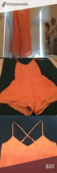 Embroidered romper Embroidered orange romper, elastic band at waist, criss cross back straps, shell is 98% polyester, 2% spandex and lining is 60% cotton, 40% polyester Forever 21 Dresses