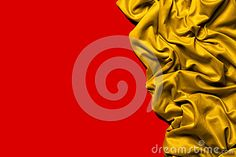 A fabric with gold colored curves and waves with draped effect. Intense color and large depth of field. Red background with space to write your text.
