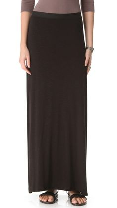 Love the long black skirt - despite the slight feeling it gives me that 90's fashion is well on it's way back in style. Gotta get me one of these.