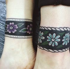 Rich Hadley black floral wristbands with borders