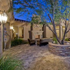 Spanish Colonial style home - through the gate in the arch opening, a lovely…