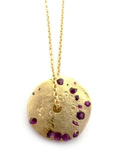 Polly Wales, crystal disc pendant with Burmese rubies.  Love!