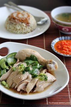 Hainanese Chicken Rice. Not quite our National dish ... but comes pretty close. To the uninitiated, it's all about the sauces - chilli and/or ground ginger, and the flavor of the rice which is cooked in chicken fat.