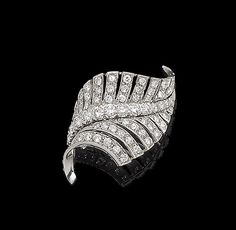 A diamond leaf brooch Of openwork design, the undulating fern set throughout with brilliant and single-cut diamonds, diamonds approx. 1.25cts total, length 3.6cm