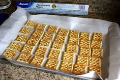 Cracker Toffee - 5 easy ingredients...saltine crackers, butter, brown sugar, semisweet chocolate chips and chopped pecans.
