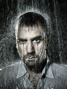 I like how the photo was taken in the rain, the person is soaking wet. I also like the lighting .