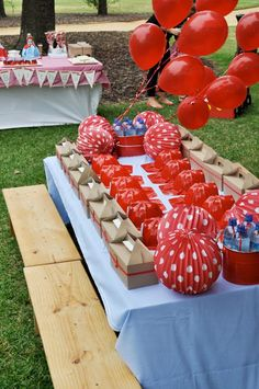 nice display for favors and hats.  groups of red balloons look better than decorated mylar balloons.  red paper plates and napkins are better than decorated plates too.