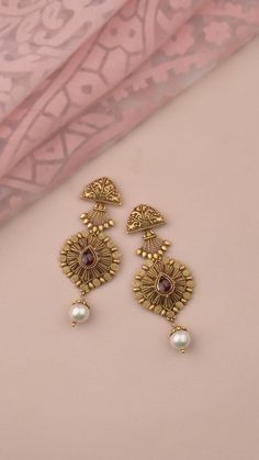 Handcrafted earrings in gold accented with pearls Indian Jewelry Earrings, Jewelry Design Earrings, Gold Earrings Designs, Ring Designs, Gold Bangles Design, Gold Jewellery Design, Gold Jewelry Simple, Bvlgari, Gold Ring