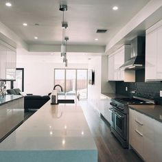 Our Hi Gloss White in a new kitchen in Encino, CA. #kitchens #remodel #whitekitchen @cabinetcity #eurostyle