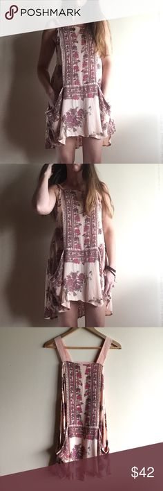 "Free People blush pink floral dress with pockets Adorable dress by FP in a pale peachy pink. Open cut out back, pockets. Great condition!! Measures 20"" from underarm to underarm and 34"" long. I am 5'7"" for fit reference. Loose, swingy fit. Free People Dresses Mini"