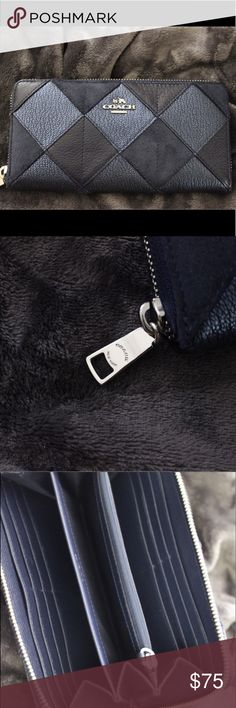 NAVY BLUE COACH WALLET This wallet is essential for the summer. With its patchwork sleek design, you will get the bang for your buck. It is long lasting, no scuffs, marks or holes. Everything is in brand new condition. With more than 5 holders for your cards, you will never have to worry about staying organized again. Coach Bags Wallets