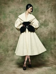 Lili Ji in Dior Haute Couture by Sun Jun for L'Officiel China.  Full skirted, portrait collar dress, with drop sleeves and full poet sleeves.  Tightly cinched wide black belt gives the dress an hour glass look.  The unique belt has two pouches ~ one on each hip ~ which creates an accent on each hip.  Black hat and shoes