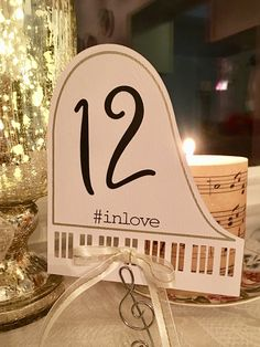 Piano-shaped table number card with cut out piano keys and ribbon. Shop for more variations Sweet Table Wedding, Wedding Table Numbers, Wedding Tables, Piano Table, Music Themed Parties, Piano Art, 70th Birthday Parties, Wedding Music, Dream Wedding