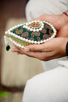 "Pavia Singh Ranhawa and Jessel Taank, Mexico. ""Pavit holding an embroidered coconut. The bride's family walks to the entrance carrying a coconut to receive the groom's party. The coconuts are then exchanged as a symbol of the marriage contract. Indian Wedding Gifts, Desi Wedding Decor, Indian Wedding Decorations, Wedding Crafts, Wedding Events, Stage Decorations, Wedding Stage, Festival Decorations, Thali Decoration Ideas"