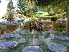 White and Sage green table linens, wooden chairs.
