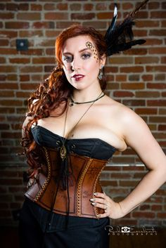 foggcouture:  The gorgeous Kitty Krell kittykrell wearing Fogg Couture foggcouture by Mistress Fogg. Black corset by Kitty Krell Photography by Rick Escalante Photography Makeup: Francesca NicholeHair: part Kitty, part both of our team.   As lovely as I find the corset I'm a bit shocked this is an official product photo, because have you seen that side boob/flesh bulking under the models arm? That black corset thingy underneath is clearly to small and/or ill fitting and it's really not…