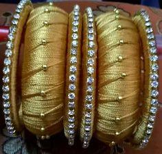 Gold silk bangles To order whatsapp on 9703870603 Silk Thread Jhumkas, Silk Thread Bangles Design, Silk Thread Necklace, Silk Bangles, Beaded Necklace Patterns, Bridal Bangles, Thread Jewellery, Jewelry Patterns, Bangles Making