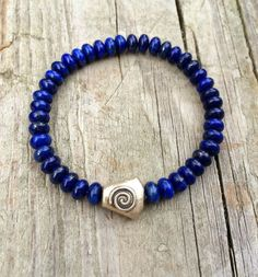 Blue Lapis Lazuli Stretch Bracelet with Silver Spiral Accent
