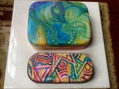 Polymer clay covered boxes by Lisa Haney.