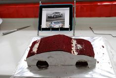 Sweet LY who previously got this Orchid Cake  and  this Damask Cake  got us to make a sculpted Porsche car cake for her pops.