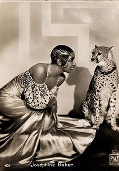 The amazing Josephine Baker and her pet leopard, Chiquita.