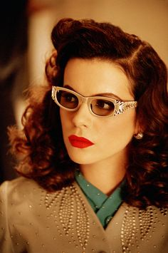 Kate Beckinsale's glam 40s style in vintage glasses and beaded cardigan in The Aviator.
