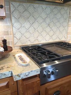Deco backsplash with subway tile in this Santa Barbara kitchen