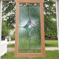 A personal favorite from my Etsy shop https://www.etsy.com/listing/292650607/handcrafted-stained-glass-beveled-art