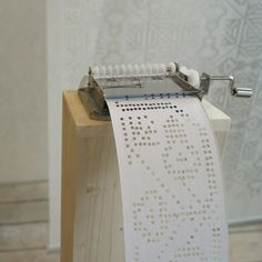 Hungarian design student Zsanett Szirmay has transferred folk embroidery patterns onto strips for a punched card music box, which plays the traditional motifs as sounds You can watch the music by the link, down below: http://www.dezeen.com/2015/01/17/zsanett-szirmay-soundweaving-cross-stitch-patterns-punched-card-music-box/