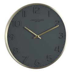 The stunning new Elvie wall clock by the London Clock Company is simply elegant and striking. The Elvie boasts raised Arabic numerals on a solid resin dial with a thin brushed metal case, bushed . Grey Wall Clocks, Black Clocks, London Clock, Modern Colonial, Kitchen Clocks, Gold Walls, Grey And Gold, Alarm Clock, Contemporary