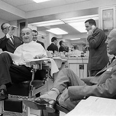 vintage barbershop....President Lyndon B. Johnson getting clipped