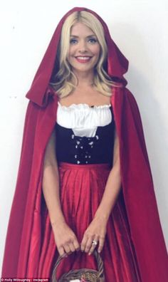 12283d8dd0 Little Red  Yet Holly Willoughby swapped chic looks for fancy dress on  Friday as she