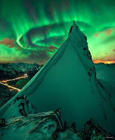 APOD: 2014 November 3 - In Green Company: Aurora over Norway. ... two nights went by with, well, clouds -- mostly. On the third night of returning to same peaks, though, the sky not only cleared up but lit up with a spectacular auroral display. ... The setting is a summit of the Austnesfjorden fjord close to the town of Svolvear on the Lofoten islands in northern Norway. The time was early March.
