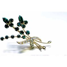 Delicate Vintage Emerald Green Rhinestone Flower Spray Gold Tone... (€27) ❤ liked on Polyvore featuring jewelry, brooches, vintage jewelry, vintage costume jewelry, pin brooch, antique costume jewelry, vintage brooches and vintage flower brooch