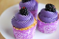 angel food cupcakes with blackberry buttercream. i love fruit buttercreams.