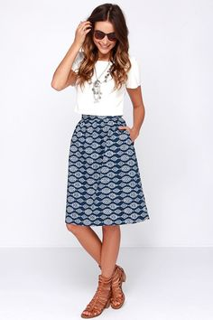 Navy Print Midi Skirt, white top, camel sandals.