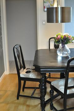 Refurbished table and chairs!...I really like this; could be done w/ any number of aged stained sets. Fun chair fabric texture.