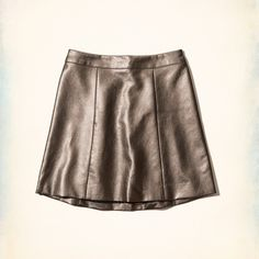 NWOT Hollister Northside Faux Leather Skirt Supersoft faux leather with a metallic finish, stitched details and a flirty silhouette. Hollister Skirts