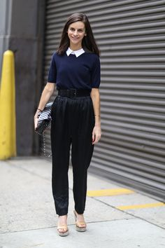Work Outfit Ideas to Try This Winter - white button-down shirt under a short sleeve sweater worn with belted tapered trousers and platform heels