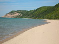 Esch Road Beach: Sleeping Bear Dunes National Lakeshore along the northwest corner of Michigan's Lower Peninsula includes 65 miles of shoreline with a number of welcoming beaches flanked by bluffs that can soar over 400 feet above Lake Michigan. Although Lake Michigan water can be rather chilly, especially early in the summer, several areas including Esch Beach have entering streams with warmer waters.