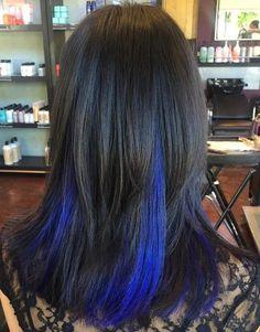 black hair with blue peek-a-boo highlights
