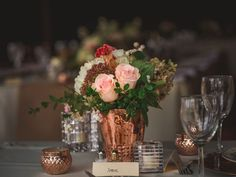 Copper vase and rose wedding centerpiece. Simple, affordable wedding decor. Click to see more of Duncan and Sarah's Wedding in Westerville, Ohio!
