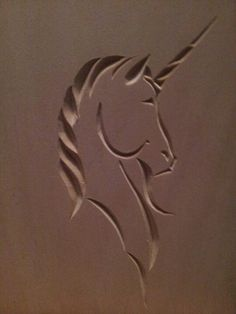 Chip carved unicorn