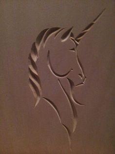 Chip carved unicorn