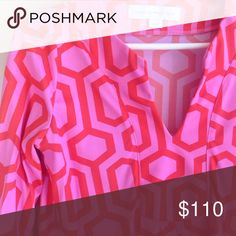 "Bright gorgeous shift dress. Bright pink with orange geometric shaped. V neck, cropped sleeves with slit accents- see 4th photo. side 6.5"" slits at legs. Synthetic material with some stretch. Armpit to armpit- 14"". Length from top of shoulder- 34.5"" shoulder to wrist- 18"" Length across bottom hem when stretched out- 23"". Ask ???s- it's been worn once, incredibly admired around a crowd of people and I likely won't repeat wearing it because it's so memorable. My $$ loss! Your gain! Best price…"