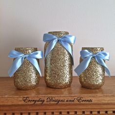 This listing will provide you with a set of 3 glass glitter mason jars decorated with gold glitter and satin bows around the mouth of the jar. limited quantities available of this set. In this set you
