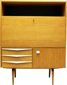 "<p>This secretaire, model ""427/E"", was designed in 1964 by Bauhaus student Franz Ehrlich for VEB Deutsche Werkstätten Hellerau. It is made from elm wood, white ash wood, laminated bent wood, white plastic and glass. The bureau is partially restored and is in a very good vintage condition.</p>"